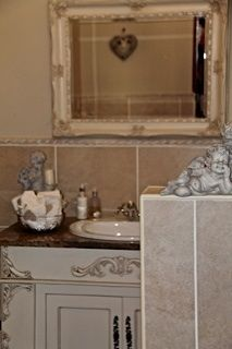 Guest loo with cherub theme