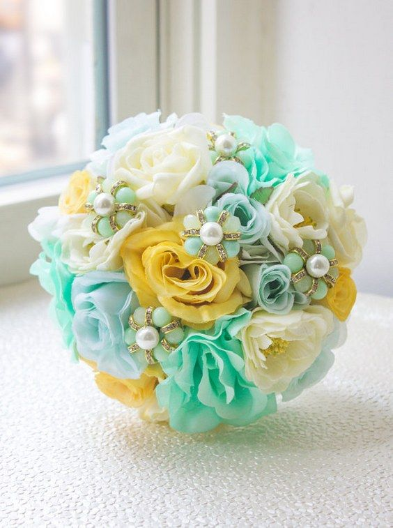 Mint Blue & Yellow Bridesmaid Bouquet / http://www.himisspuff.com/mint-and-yellow-wedding-ideas/8/
