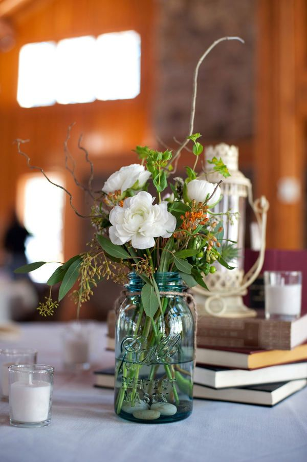 Wildflowers, mason jars, and book center pieces!
