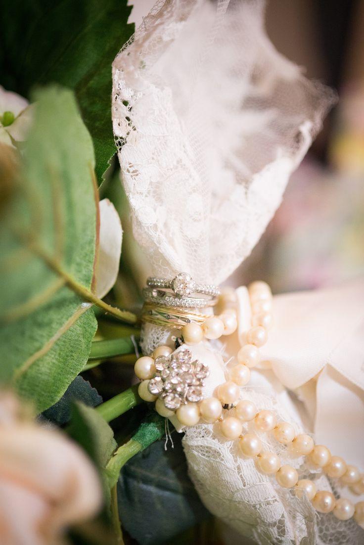 Wedding bands in the bridal bouquet #grandmaslace #omasperals #vintage