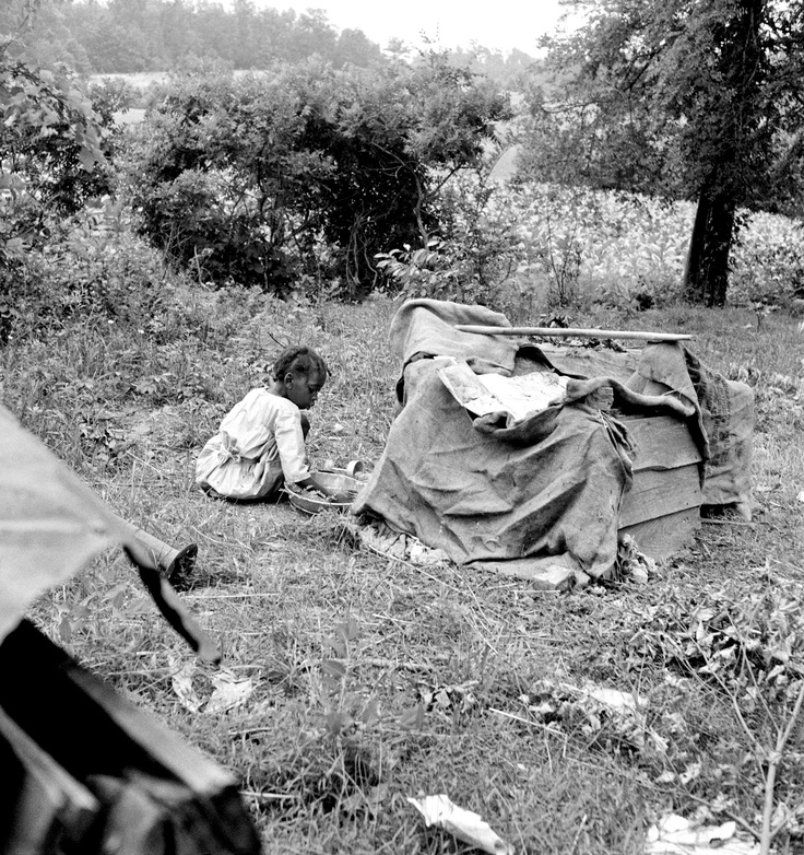 Tobacco sharecropper child playing. Note burlap covered playhouse.   Person County, North Carolina, 1939
