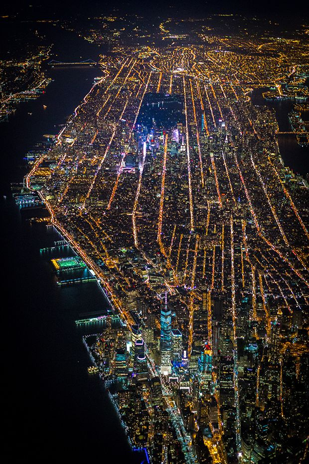New York City At Night - THESE EXTRAORDINARY AERIAL PHOTOGRAPHS CAPTURE THE PULSE OF NEW YORK CITY Never has the city that never sleeps looked more alive. By Elizabeth Griffin 1/15/15 - Esquire: