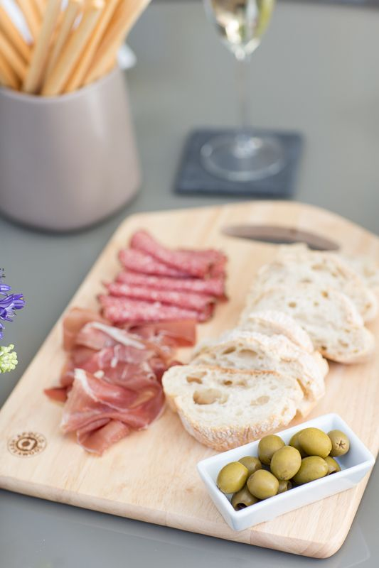 Don't feel like cooking a full meal? Cut some fresh bread and pair on a wooden board with light bites like olives and charcuterie. A collection bowls of dips such a hummus and pesto will match perfectly with some crunchy breadsticks, letting you get on with enjoying the evening.