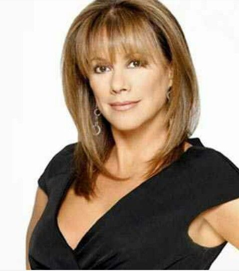 Nancy Lee Grahn from General Hospital. Love the hair and color.