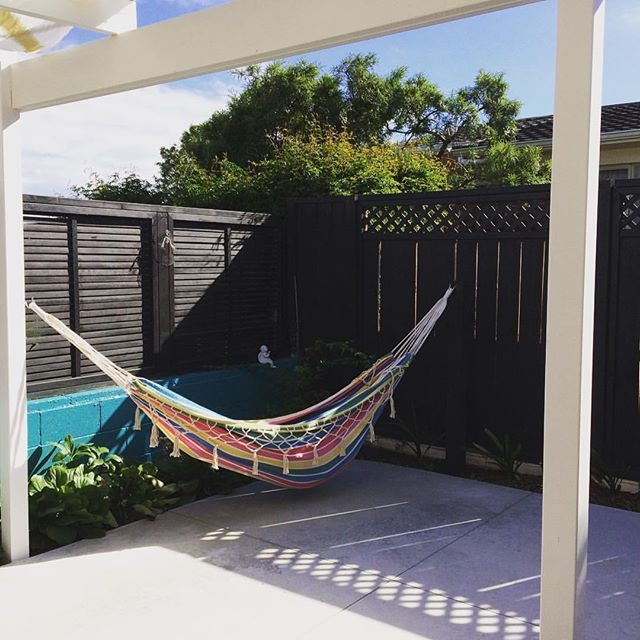 My hubby had just installed the Christmas present him and the kids got me. So lucky!!!! Looking forward to #relaxing in this once I've finished sewing up the fabric to go under the portico for our #moroccan inspired courtyard.  #garden #hammock #stripes #outdoors #homeandgarden #courtyard #exteriordesign #thisisthelife #newzealandsummer