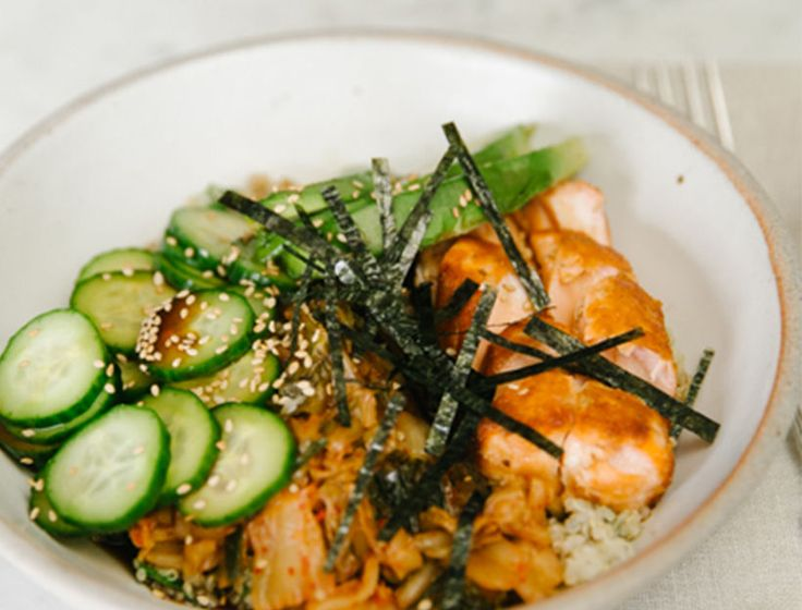 Grain bowls are genius: easy to make, super versatile, and always filling. We top this one with pan-seared salmon, but grilled chicken or tofu would also work well.