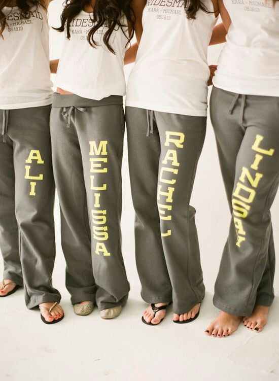 Matching sweatpants with each bridesmaids name on them. Can be used to workout together or getting ready before your wedding day!