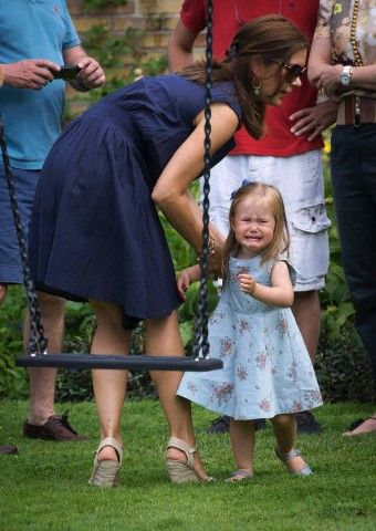 Crown Princess Mary was trying to calm down her crying daughter Princess Josephine that wants to get on to the swing.