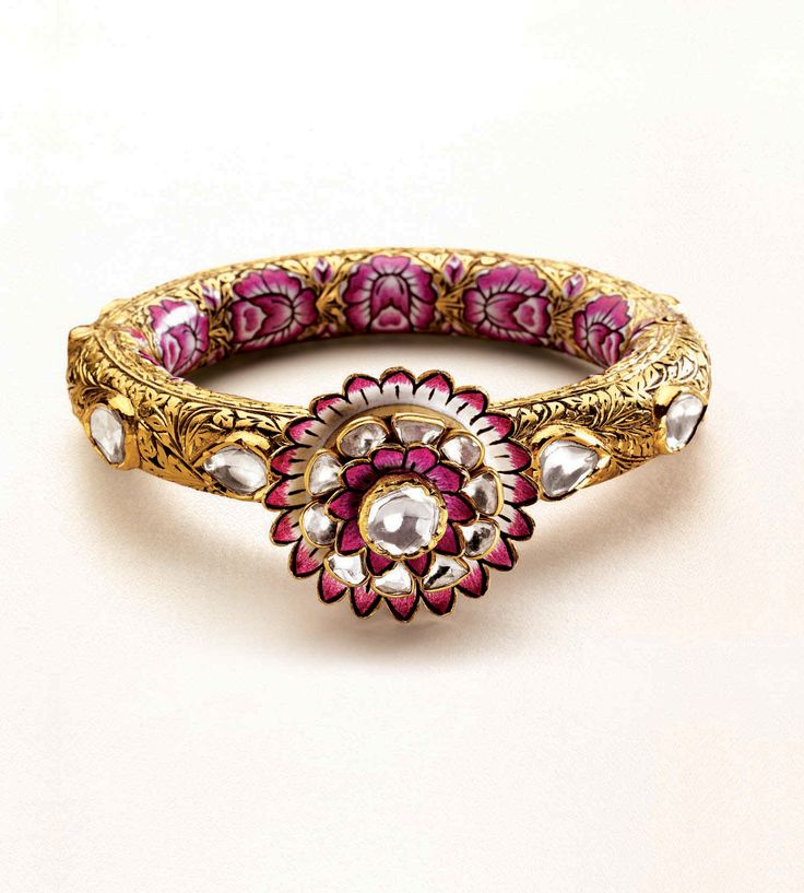 Zoya bangle featuring a three-dimensional lotus, in yellow gold with polki diamonds, engraving and enamel work