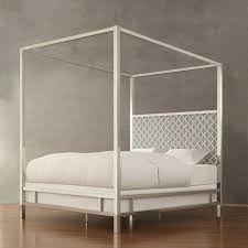 Canopy Bed with Gray White Upholstered Headboard
