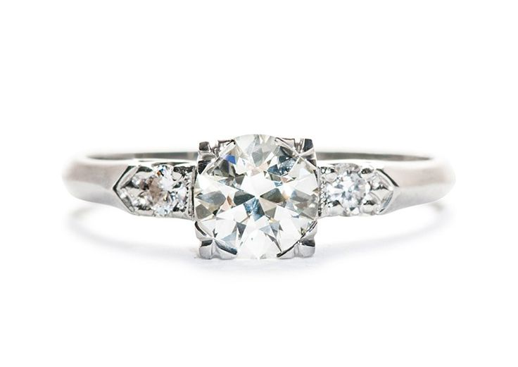 Smithville is a classic 1950's platinum engagement ring centering a .85ct Transitional Cut diamond accented by two full cut diamond and a crisp knife-edge shank for a modern, minimalist look. TrumpetandHorn.com   $4,400