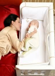 baby shelf attaches to bedside of mother. best of both worlds to breastfeed in the night without risking turning over on to the baby while asleep. (although i never did when i slept with my baby until 18 months -- but some people are heavier sleepers). i would have used this if it had been available at the time.