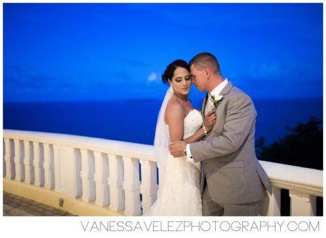 As the sun sets a loving moment between the bride and groom is captured at Trellises at El Conquistador Resort. Destination Wedding | El Conquistador Resort & Las Casitas Village | Puerto Rico | ElConResort.com Vanessa Velez Photography
