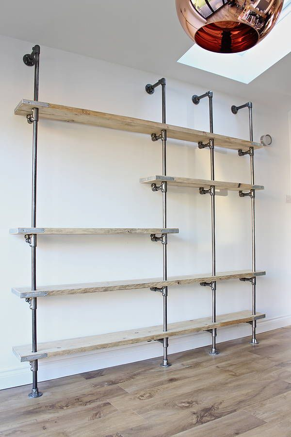 Scaffolding board and steel pipe shelving by Inspirit