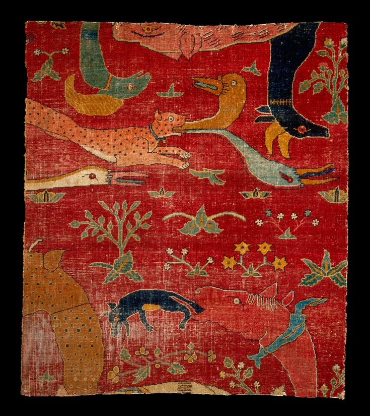 fragment: pile | wool on cotton ground | 78 cm × 67 cm | Mughal, India | c. 1600 | presumed to have been made for the court of the Great Mughal Akbar