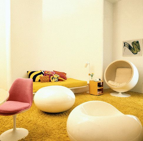 had a modern room with white wallscanary yellow shag carpet pink accented tulip chairs and white ball chair by saarinen