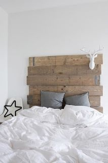 bed's wooden plank headboard