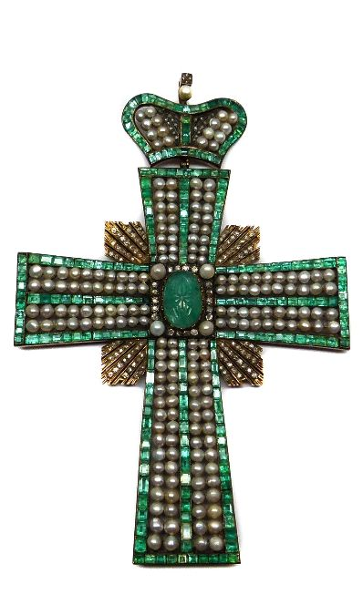 Large 19th century emerald, pearl and diamond cross pendant with coronet surmount, Russian c.1850 , the straight tapered arms set with lines of rectangular cut emeralds, filled with double rows of pearls, centred by a carved oval cabochon emerald, a square of radiating diamond lines to the middle between the arms, from a hinged similarly set coronet, close set Length 17cms