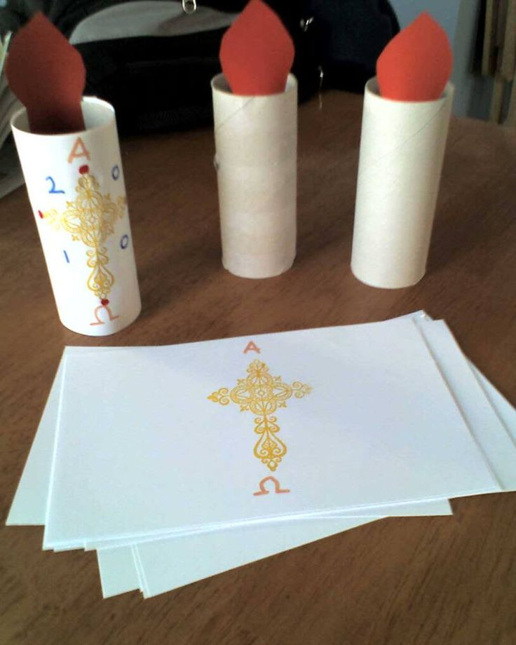 Kids' craft for Easter: the Paschal candle. It's a very tall candle lit at Easter, baptism and funerals in the Catholic church. The candle has a very specific design - start it with a rubber stamp cross and make a sample, then kids can inish the pattern and glue the pattern to the toilet paper tubes. You'll get a better impact of the size of the candle if you can use paper towel tubes.