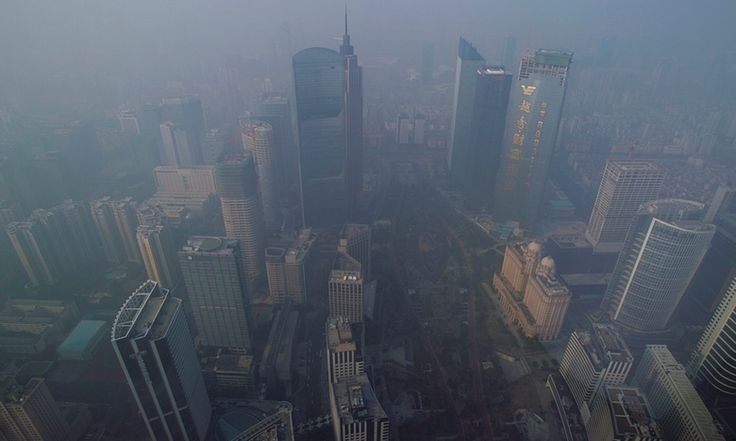 Buildings are seen through thick haze in the central business district of Guangzhou, part of the Pearl River Delta urban area.