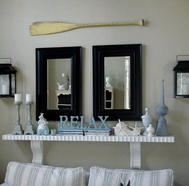 I love the idea of putting a wooden oar up as decoration Lake house decorating photos