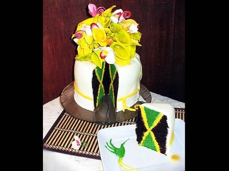 The Jamaican flag is represented in this amazing, one-of-a-kind cake; and check out the Dr. Bird on the plate! Awesome
