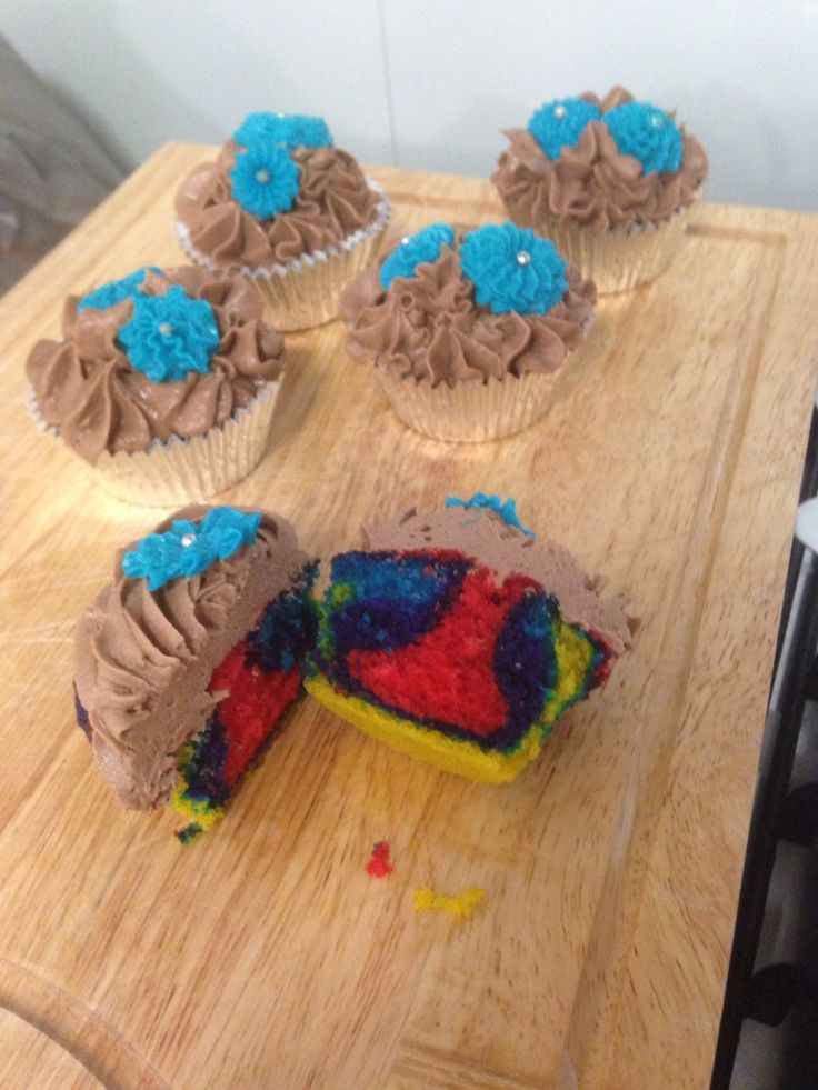 Surprise pride cakes for my religious extended family.  Nutella frosting, vanilla cake.