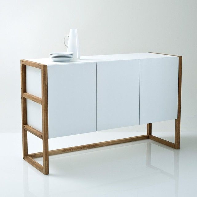 With its combination of oiled solid oak and white MDF, the Compo Scandinavian style 3-door sideboard is as beautiful as it is practical. Great for storage and to display your beautifulFeatures:Interior includes two fixed shelvesSolid oak uprights with an oiled finishLacquered MDF box and shelves with nitrocellulose varnishDimensions (cm):Overall size:W132.8cm x H84.2cm x D42cm.Usable size:L81.5cm x H25.5cm x D39cm.Compartments: 40 x 25.5 x 39cm