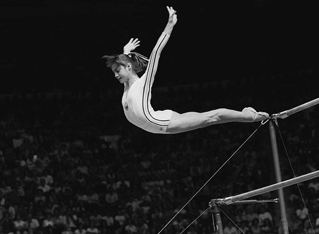 Nadia Comaneci - Romanian gymnast, winner of three Olympic gold medals at the 1976 Summer Olympics in Montreal and the first female gymnast to be awarded a perfect score of 10 in an Olympic gymnastic event.On her first day of competition, Comaneci produced a stunning performance on the parallel bars. With unrivalled grace and ingenuity, she completed a flawless routine and was awarded the perfect score by the judges: 10.00