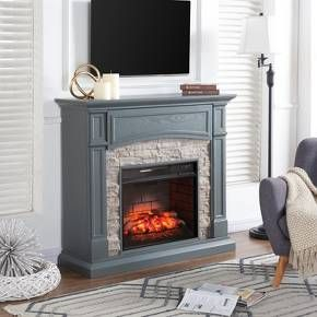 Freshen up your look with the Aiden Lane Salski Infrared Media Fireplace. Lifelike faux stone surrounds the firebox, while the console fireplace's flip-up media shelf with cord control keeps you fully organized.