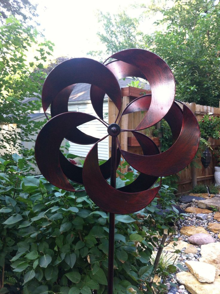 create a grand display in your garden with these large 2 foot Kinetic wind Sculptures. The Dual metal pinwheels rotate freely in the breeze. Once only seen in the most elite gardens, these metal pinwheel spinners are now available for under $80 at gifte-mart.com Several styles to choose from - all with videos to see them in action first! please visit us at gifte-mart.com