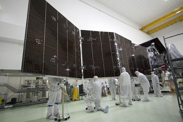 Jupiter bound Juno spacecraft breaks solar power distance record, as the most distant solar powered probe ever flown.   (Technicians work on one of the Juno spacecraft's three solar panels before launch. Credit: NASA/JPL-Caltech/KSC)  Article>