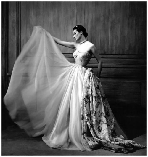 Capucine wearing an evening gown by Pierre Clarence, 1953, photographed by Georges Dambier at La Tour D'argent, Paris