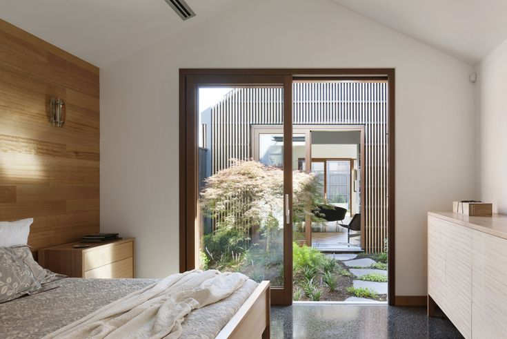 opening to courtyard, timber wall panel