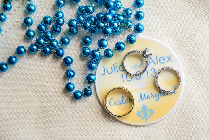 Personalized mardi gras bead wedding favors.