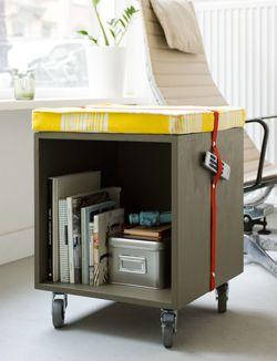 a simple cube, some modern paint colour, wheels and a comfy cushio