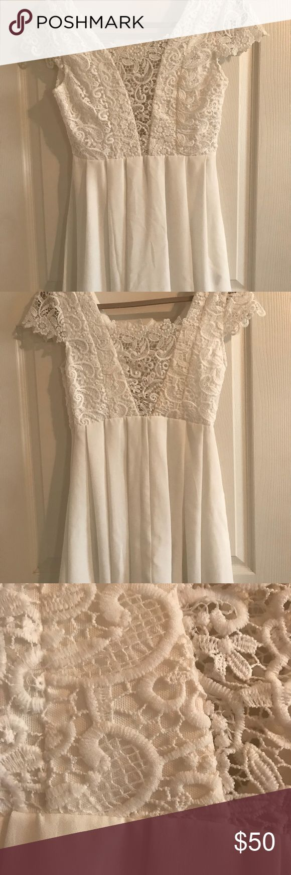 """Lulus white dress Batchorlette or fun party dress! Bought it for a batchelorette party. Never worn. Tags have been removed.    Medium: Bust- 35""""-36"""" Waist- 28""""-29"""" Hip- 37""""-38""""  US Size 4  A fitted top with a deep V neckline in both front and back covered in see through lace. See through short sleeves, and a pleated chiffon skirt that flows. Hidden side zipper. Partially lined. 100% Polyester. Hand Wash. Lulu's Dresses Mini"""
