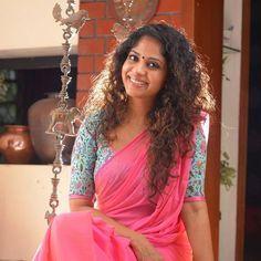 Pretty cotton sari or saree with 3/4th printed blouse. Indian fashion.