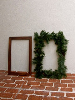 A frame and some Christmas greens-add battery operated twinkle lights!