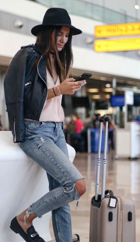 relaxed smart casual airport style + distressed jeans + leather jacket + little black fedora + hat + endless authenticity + undoubtedly be in fashion wherever you fly to + Via Federica L.   Brands not specified.