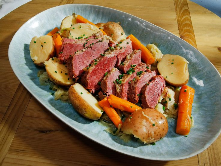 Get this all-star, easy-to-follow Slow-Cooker Corned Beef and Cabbage recipe from Jeff Mauro