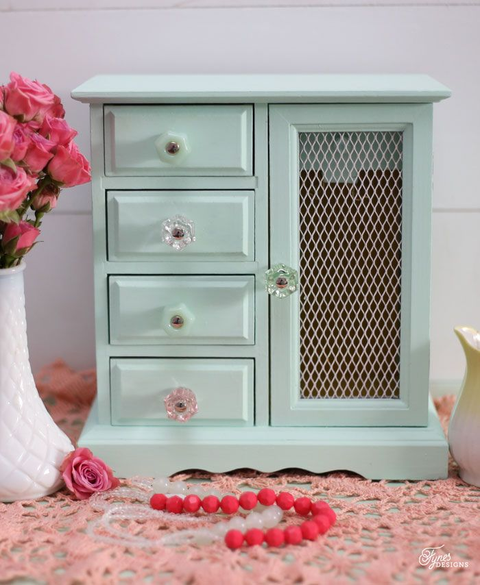 This cute little jewelry box makeover from Fynes Designs features a cute mix or our antique style glass knobs!