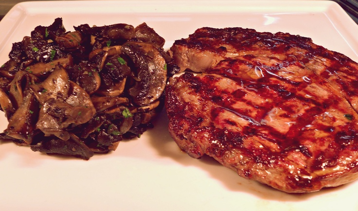 Grilled Argentinian rib-eye steak with sauteed champignons
