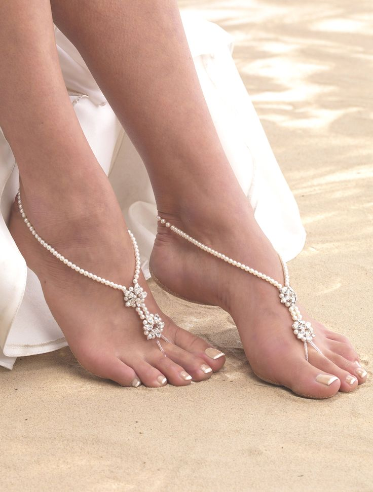 ARS001 Double Star Barefoot Sandals. Simple pearl bridal barefoot sandals with marquise set diamantes hand wired into a two-star design on each sandal.