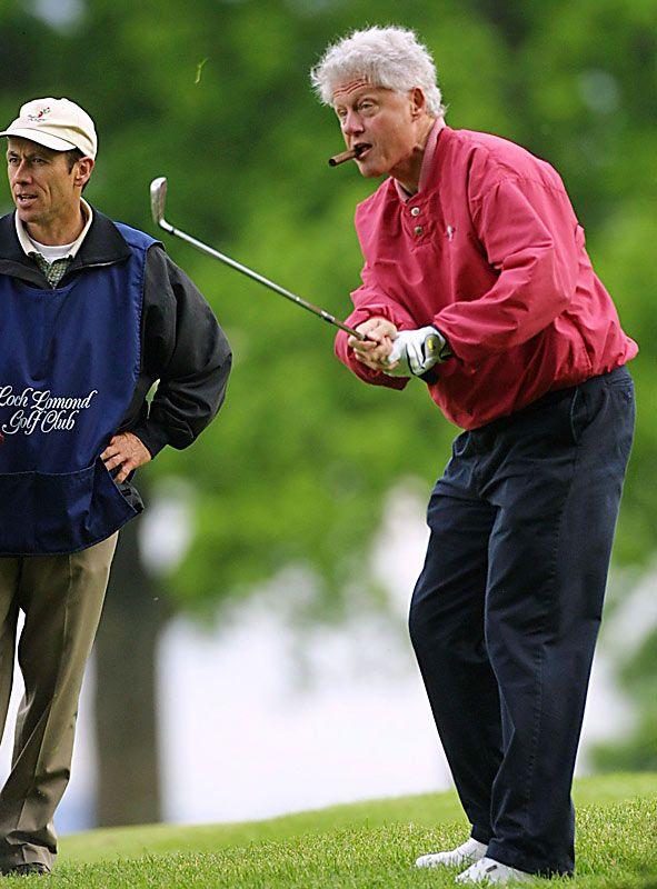 2001  Bill Clinton enjoys a cigar while shooting a round at Loch Lomond Golf Club in Scotland.