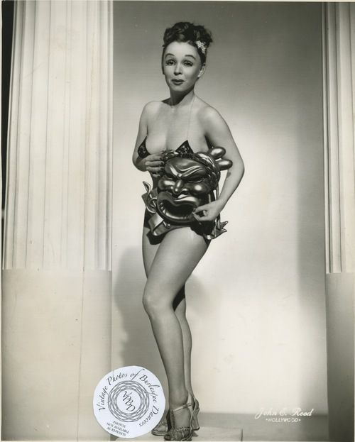 Betty Rowland poses in a racy promotional photo from her career as a burlesque dancer.