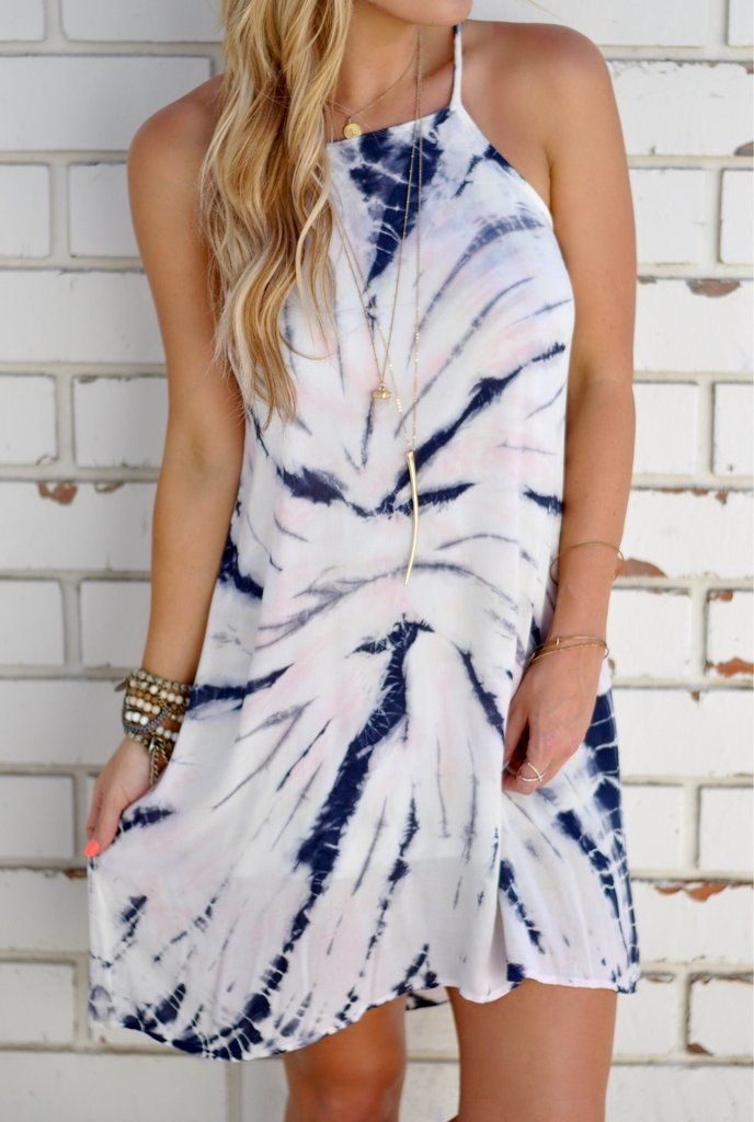 """Ivory pastel tie dye halter dress with a subtle hi-low hem. Fully lined.  100% Rayon 34"""" length 