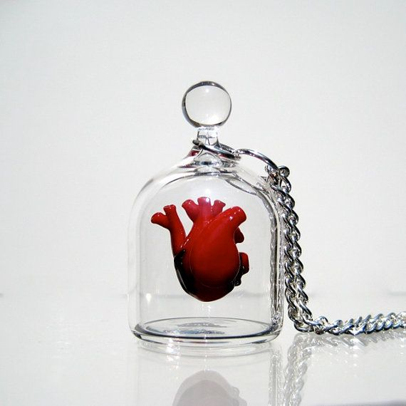 Blown glass anatomical heart in a jar necklaces. This looks so incredibly difficult to make.