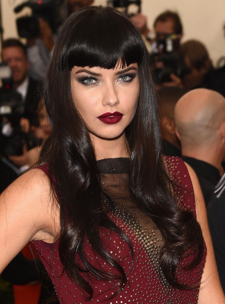 Adriana Lima can make herself look like a totally different person with a simple change of clothes, a variation on her lipstick, or a subtle hair change. The Brazilian beauty can be sexy and flirty at the Victoria's Secret Fashion Show, slightly manly wearing a three-piece suit, and even goth with the help of the right eye makeup.