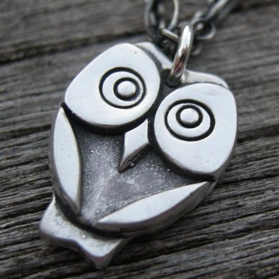Cute owl necklace. And its name is DESMOND. If only I had $61.00 to spend on it, brothah.